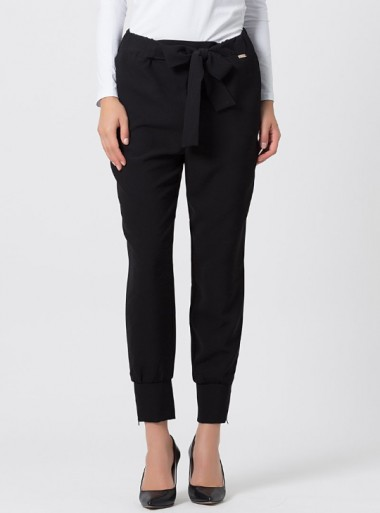 PANTS WITH BOW AT THE WAIST AND CUFFS Midnigia